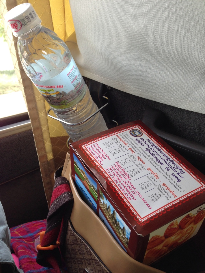 FREEBIES. A bottle of water and pizza is distributed just after leaving the bus terminal in Ho Chi Minh City, Vietnam.